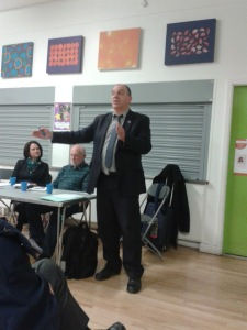 Councillor Andrew Cooper addressing packed and enthusiastic audience